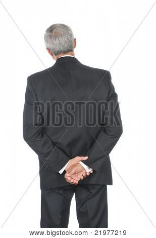 Middle Aged Businessman with his hands behind back Head tilted to one side isolated over white