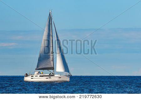 White Sailboat Traveling At Riga