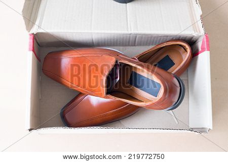 Beautiful brown leather men's shoes in box