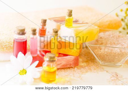 Relaxing bath and massage set. Spa, massage, bath accessories, aromatherapy concept. Fruit soap, bath salt, aromatic oils and flower.