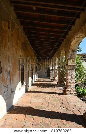 San Juan Capistrano Ca - December 1 2017: Walkway and arches at the San Juan Capistrano Mission in Souther California.