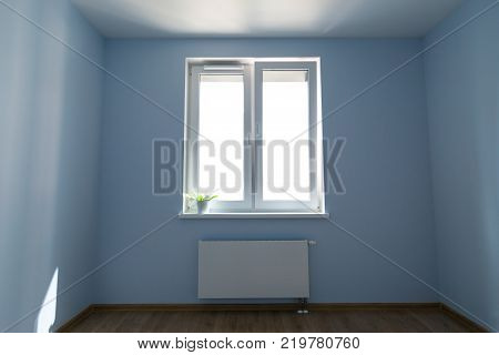 Interior of empty unfurnished room with walls, window and radiator, nobody