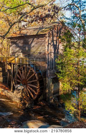 Grist Mill and the creek in the Stone Mountain Park in sunny autumn day Georgia USA