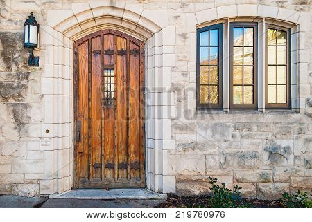 Wooden door and window on the stone facade of historic building Atlanta USA