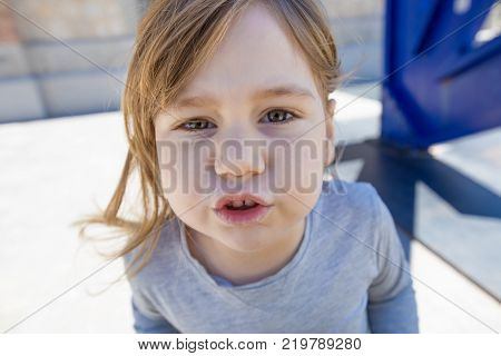 Close Up Face Of Child Gesturing