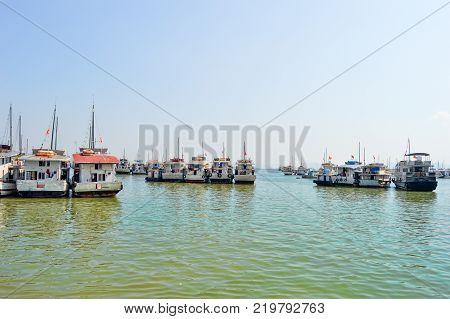 Multiple Halong Bay Junks waiting for Tourists. Halong Bay Vietnam - October 2015