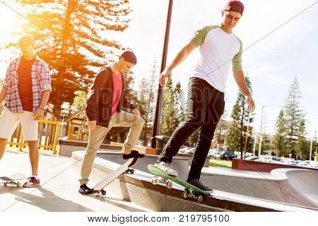 Teenage boys skateboarding outdoors