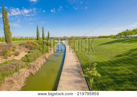 colorful landscape of waterway in public park named Juan Carlos in Madrid city Spain