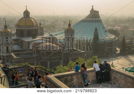 VILLA OF GUADALUPE MEXICO CITY DECEMBER 02 2017 - Visitors enjoy a panoramic view of the Old and New Basilica of Guadalupe from a balcony of the Church of the Hill.