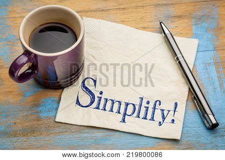 pragmatic or get organized concept, simplify reminder -handwriting on a napkin with a cup of coffee