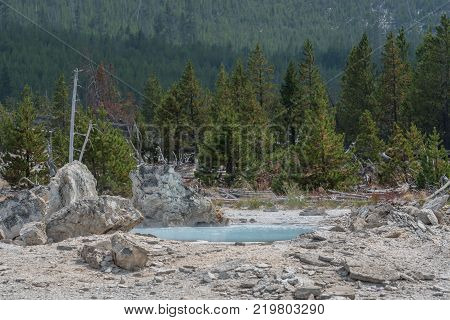 Blue Pool of Hot Springs in Yellowstone Wilderness