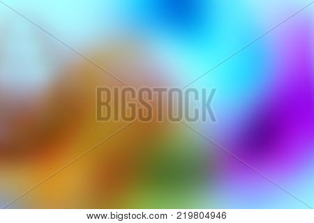 Abstract blurred background. Blur image of blue-pink-yellow light. Blurred Lights on blue, yellow and pink background or Lights on blue, yellow and pink background.