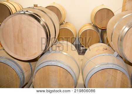 A Wine Barrels Stacked In The Cellar