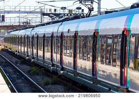 Metro train in Paris moving on the ground to the outlying areas.