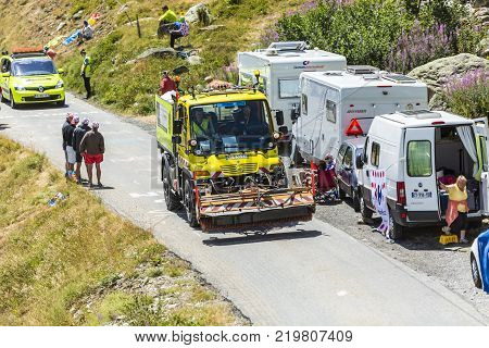 Col de la Croix de Fer France - 25 July 2015: Technical truck used to prepare the roads before the apparition of the cyclists pass on the road to the Col de la Croix de Fer in Alps during the stage 20 of Le Tour de France 2015.