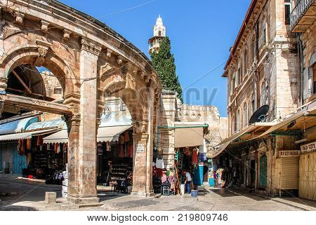 JERUSALEM ISRAEL - AUGUST 05 2010: Vertical picture of Suq Aftimos the market in Muristan Street in the old city of Jerusalem Israel.