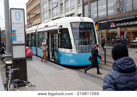 Gothenburg Sweden - April 16 2017: One blue tram in service on line 6 of clkass M32 has stopped at the tram stop Brunnsparken in downtown Gothenburg on street Norra Hamngatan.