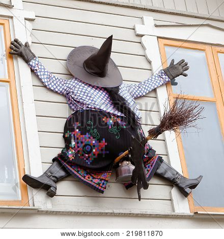 Trosa Sweden - April 5 2015: One Easter witch has crashed in to the Cafe Marsipangarden buildings wall.