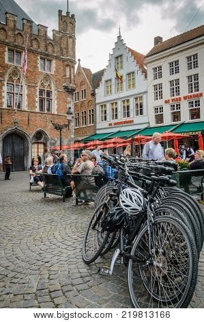 Bicycle parking near traditional street cafe on Grote Markt square in medieval city Brugge, Belgium, October, 01, 2014.