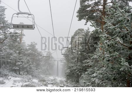 Recreation, view of the chairlift for skiers in the practice of sky, Port of Navacerrada in Madrid, Spain.