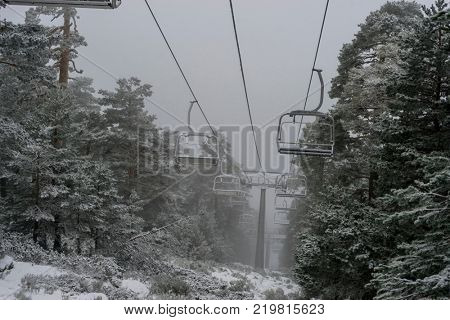 view of the chairlift for skiers in the practice of sky, Port of Navacerrada in Madrid, Spain.