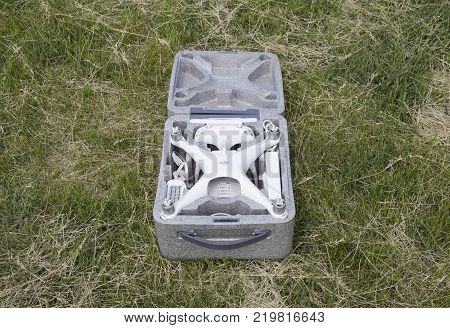 Russia, Poltavskaya village - May 13, 2016: Open case with quadrocopters DJI Phantom 4. The opening of the box on the lawn.