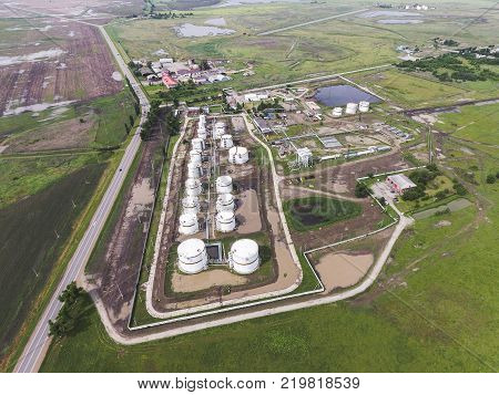 Aerial view of oil storage tanks. Industrial facility for the storage and separation of oil.