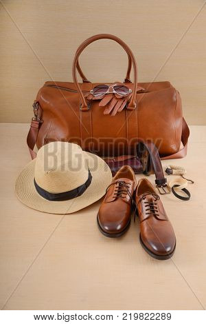 Men's casual outfits with man scarf and accessories on wooden background,
