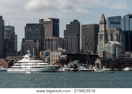 Boston MA USA 05.09.2017 - Mayan Queen Yacht sailing boats on Charles River in front of Boston Skyline on sunny summer day