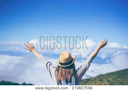 Young Woman Traveler With Sky Blue Backpack And Hat Looking The Map With Tuk Tuk Thailand Background