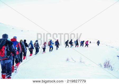 winter hiking and climbing activity & trekking & hiking & mountain climbing & camping