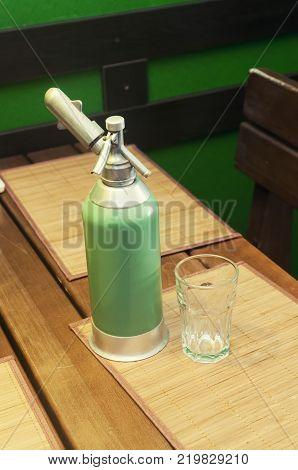 Green vintage soda syphon. For making soda at home.
