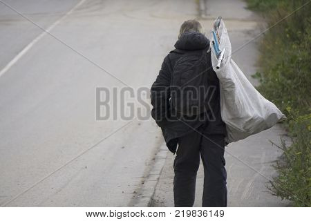 homeless man holding Lifestyle of tramp living in the streets.