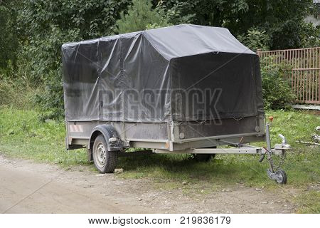 car trailer with leather awning the trailer is on wheels