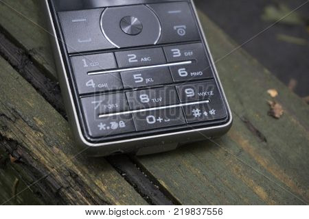 Closeup of mobile phone keypad the past generation