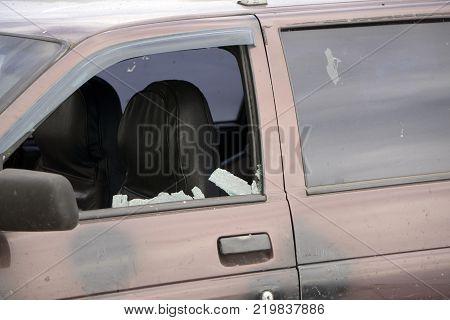 shattered glass Broken side window in a car.