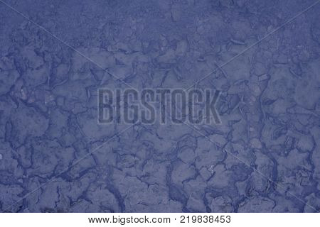blue Earth dry and cracked land. pieces near