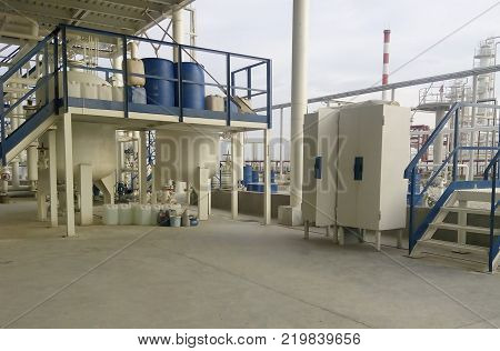Tool box and a playground pouring chemical. The equipment for oil refinery.