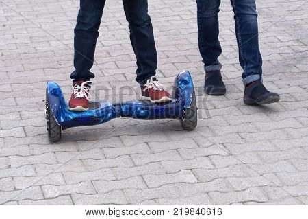 l riding on hover board or gyroscooter outdoors at sunset in summer. Active life concept