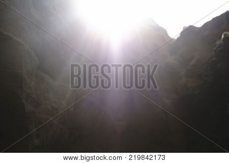 the sunlight penetrates through the top Gorge and vast high desert
