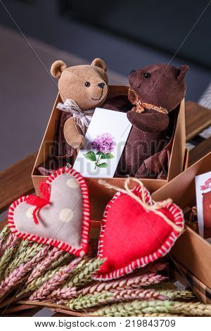 pair amorous of Teddy bears in a gift box for Valentine's day