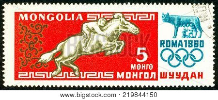 Ukraine - circa 2017: A postage stamp printed in Mongolia shows drawing Horse Riding. Series: Summer Olympics 1960 Rome. Circa 1960.