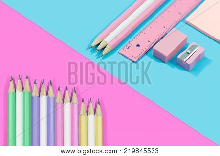 Stationary concept Flat Lay.  Stationary  pastel tone on blue and pink background with copy space.