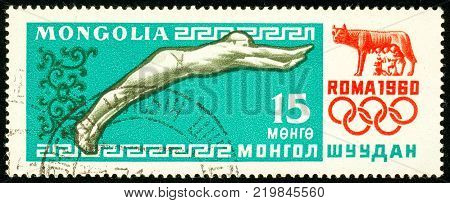 Ukraine - circa 2017: A postage stamp printed in Mongolia shows drawing Swimming. Series: Summer Olympics 1960 Rome. Circa 1960.