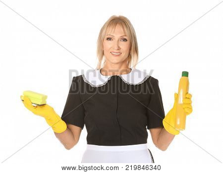 Mature charwoman with bottle of detergent and sponge on white background