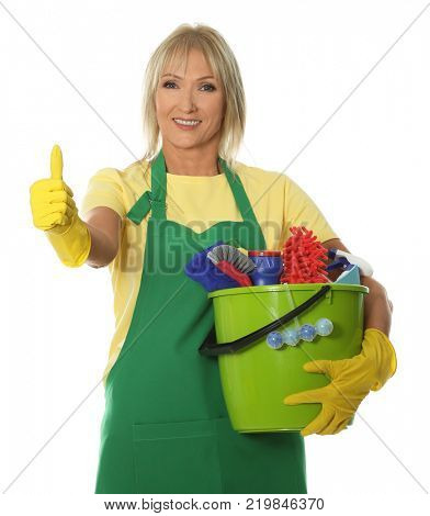 Mature woman with cleaning supplies on white background
