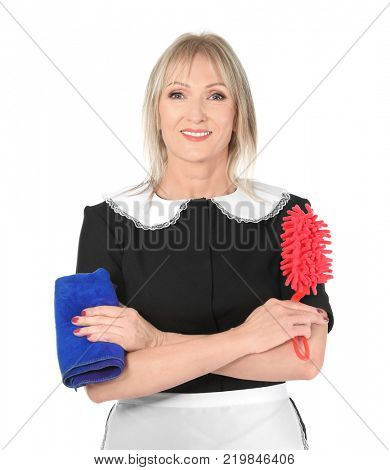 Mature charwoman with duster and rag on white background