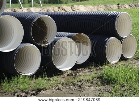 Corrugated plastic pipes at a construction site