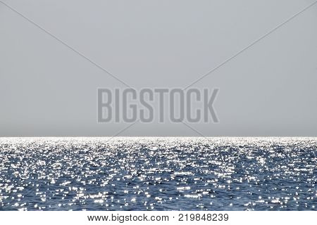 Sea line of the horizon. Sea and sky. The waves and glare of the sun are reflected from the waves of the sea. Seascape