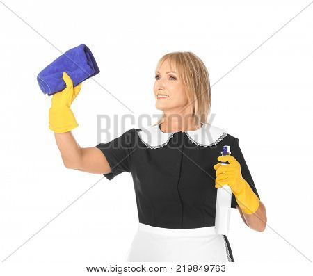 Mature charwoman with bottle of detergent and rag on white background
